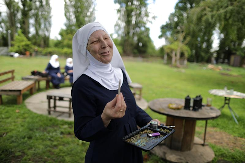 """California """"weed nun"""" Christine Meeusen, 57, lights a joint at Sisters of the Valley near Merced, California, U.S., April 18, 2017. Picture taken April 18, 2017. REUTERS/Lucy Nicholson"""