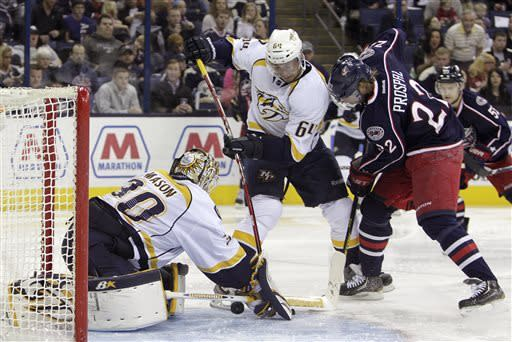 Nashville Predators' Chris Mason, left, makes a save as teammate Victor Bartley, center, and Columbus Blue Jackets' Vinny Prospal, of the Czech Republic, look for the rebound during the second period of an NHL hockey game on Saturday, April 27, 2013, in Columbus, Ohio. (AP Photo/Jay LaPrete)