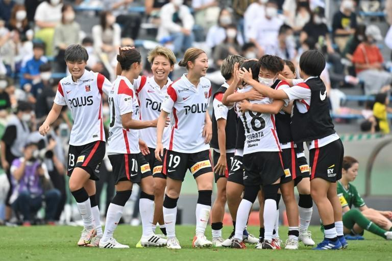 Urawa Reds Ladies' players celebrate their victory after the WE League football match against Tokyo Verdy Beleza in Tokyo on September 12, 2021. (AFP/Kazuhiro NOGI)