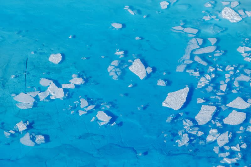 FILE PHOTO: Chunks of ice float inside of meltwater pools on top of the Helheim glacier near Tasiilaq, Greenland