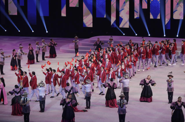 Vietnam's team march during the opening ceremony of the 30th South East Asian Games at the Philippine Arena, Bulacan province, northern Philippines on Saturday, Nov. 30, 2019. (AP Photo/Aaron Favila)