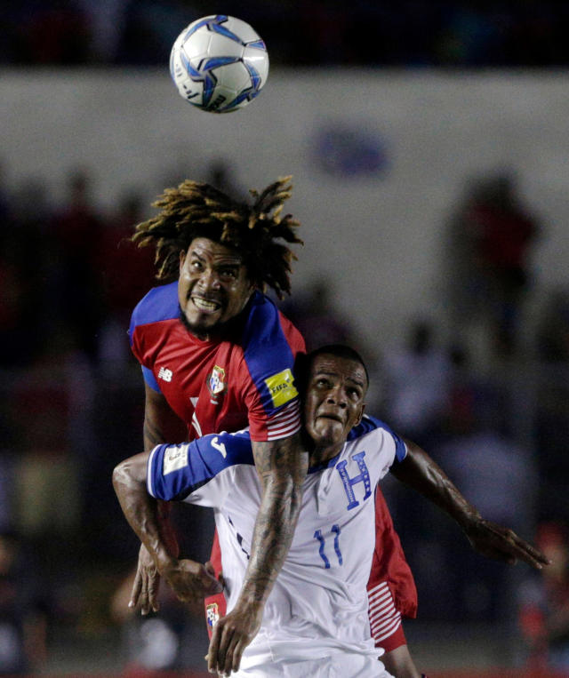 FILE - In this Tuesday, June 13, 2017 filer, Panama's Roman Torres, top, and Honduras' Rony Martinez vie for the ball during a 2018 Russia World Cup qualifying soccer match at Rommel Fernandez Stadium in Panama City. (AP Photo/Arnulfo Franco, File)