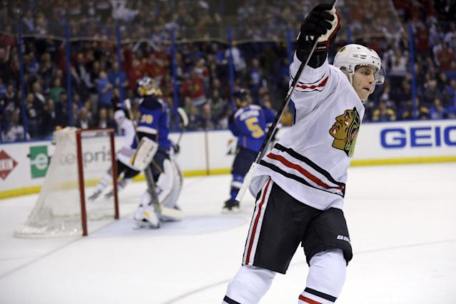 Chicago Blackhawks' Patrick Kane celebrates after scoring during the first period in Game 1 of a first-round NHL hockey Stanley Cup playoff series against the St. Louis Blues on Thursday, April 17, 2014, in St. Louis. (AP Photo/Jeff Roberson)