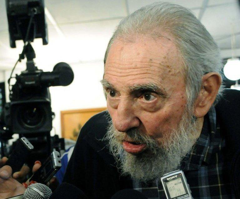 Former Cuban president Fidel Castro talks to the media after casting his vote in in Havana on February 3, 2013