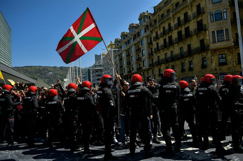<strong>Basques pro-independence supporters hold Ikurrina (Basque flags and Catalonia independence flag known as ''estelada'') flags as they clash with riot police.</strong> (Photo: ASSOCIATED PRESS)