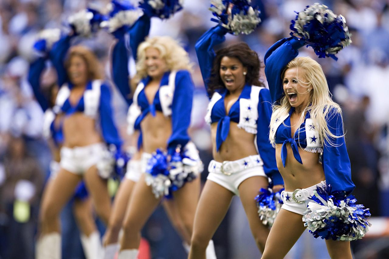 Cheerleader of the Dallas Cowboys performs during a game against the New York Giants during the NFC Divisional playoff at Texas Stadium on January 13, 2008 in Dallas, Texas. The Giants defeated the Cowboys 21-17. (Photo by Wesley Hitt/Getty Images)