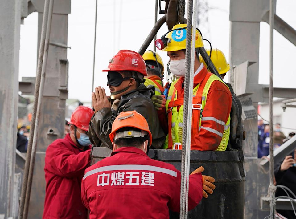 The death toll has risen to 10 after 22 Chinese miners were trapped underground (CNS/AFP via Getty Images)