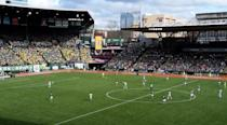"""<p><strong>Tell us about this stadium?</strong><br> Home to the Portland Timbers, Portland Thorns, and Portland State Vikings, this historic stadium, built in 1893, has seen a lot in its day—from cricket matches and ski jumping competitions to a hysteria-inducing 1957 Elvis concert. If you're in town on a Timbers game day, don't be surprised to stumble into a sea of green-and-gold scarf–wrapped residents marching resolutely toward Providence Park—team spirit runs high for Portland's beloved Major League Soccer team, and their impassioned fan group, the Timbers Army, is famous throughout the league for its undying devotion. As such, the Army's signature acronym is RCTID (Rose City 'Til I Die).</p> <p><strong>How are the seats?</strong><br> With a few exceptions, it's hard to find a bad seat here, you may want to avoid the uncovered front seats if you forgot your green poncho though. But for many, especially the non-soccer-savvy, the best seats are less about sight lines and more about proximity to the Timbers Army, which makes for a very good time on game day, whoever wins or loses. Originally based in section 107, the group now takes over the stadium's north end (specifically sections 101-108 and 202-208), so book accordingly; adult language flies during matches and things can get pretty rowdy. The whole affair is best summed up by one of the Army's favorite chants; """"We are Timbers Army; We are mental and we're barmy; True supporters forevermore.""""</p> <p><strong>We're here for the game, but how are the concessions?</strong><br> As far as ballpark food goes, Providence Park scores pretty high. The concession stands sell local craft beer and cider; The Double Post Bar, near section 109, and the 36-tap The Axe and Rose, near section 119, have the best selection. You can get a cheeseburger made with grass-fed beef and Tillamook cheddar, and the Portland Timbers Food Cart Alliance brings in popular food carts like Koi Fusion, Bokie Dokie, and Kim Jong Grillin'.</p>"""