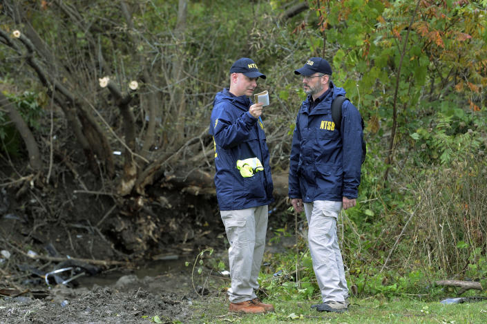Members of the National Transportation Safety Board work at the scene of yesterday's fatal crash, in Schoharie, N.Y., Sunday, Oct. 7, 2018. (AP Photo/Hans Pennink)