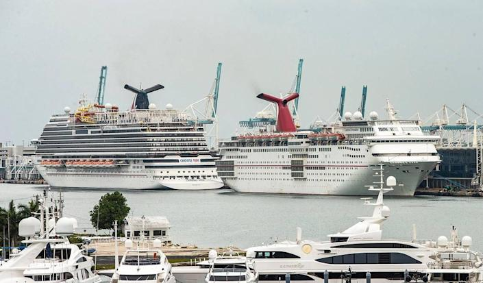 Cruise Ships Carnival Vista, left, and Carnival Sensation from Carnival Cruise Line, are seen docked at PortMiami after the CDC released a new phase of the Framework for Conditional Sailing Order for cruise ships operating or seeking to operate in U.S. waters, on Wednesday, April 21, 2021.