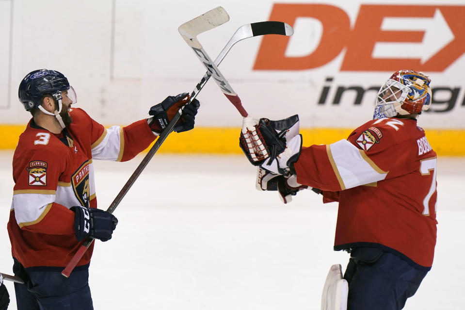 Florida Panthers defenseman Keith Yandle (3) and goaltender Sergei Bobrovsky (72) celebrate after the Panthers beat the Chicago Blackhawks 6-3 in an NHL hockey game, Monday, March 15, 2021, in Sunrise, Fla. (AP Photo/Wilfredo Lee)