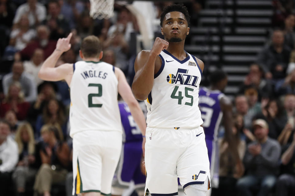 Utah Jazz guard Donovan Mitchell (45) reacts after a basket and a foul for teammate center Rudy Gobert (27) in the second quarter against the Sacramento Kings at Vivint Smart Home Arena. Mandatory Credit: Jeff Swinger-USA TODAY Sports