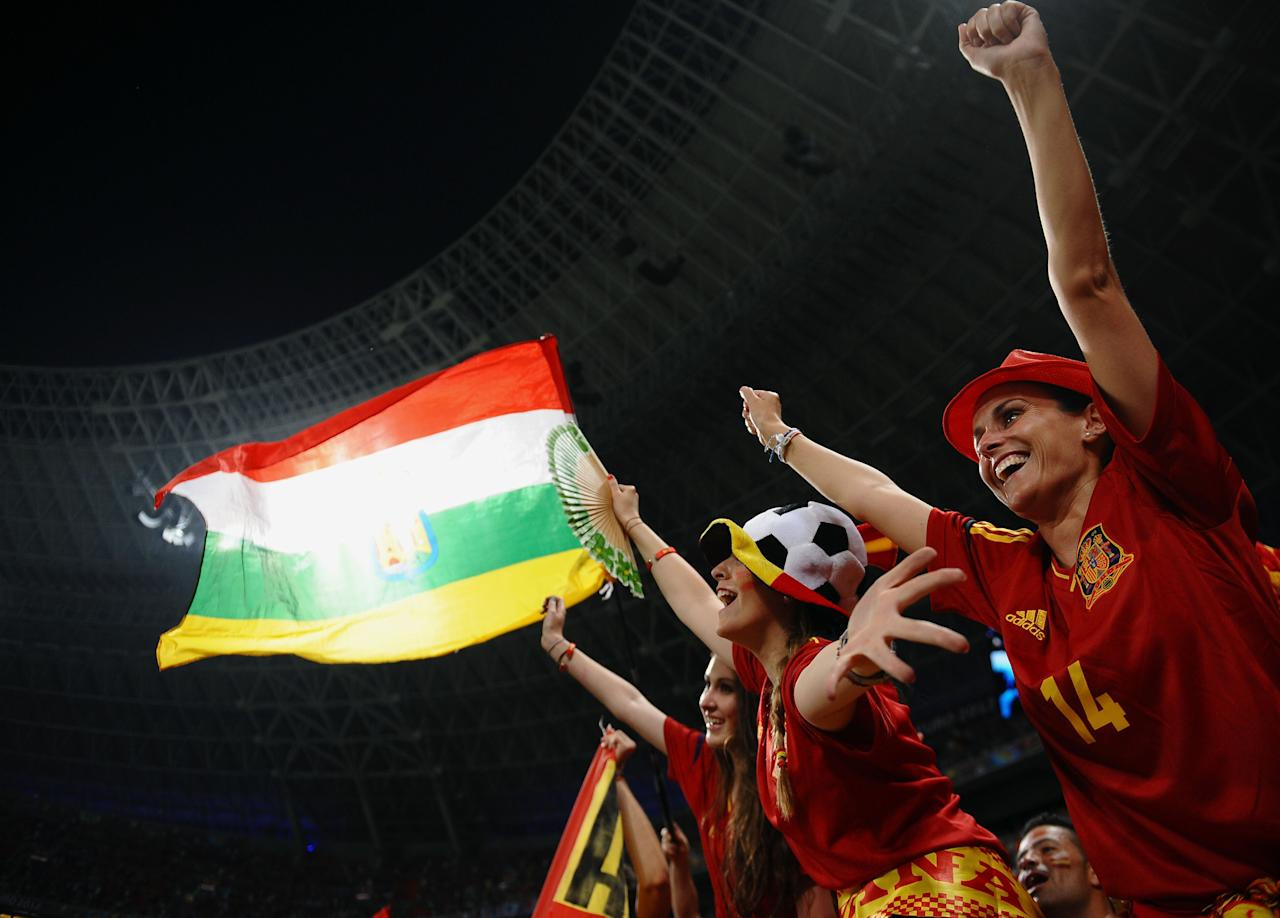 DONETSK, UKRAINE - JUNE 23: Spanish fans cheer ahead of the UEFA EURO 2012 quarter final match between Spain and France at Donbass Arena on June 23, 2012 in Donetsk, Ukraine.  (Photo by Laurence Griffiths/Getty Images)