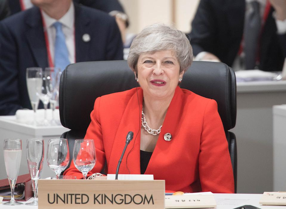 British Prime Minister Theresa May at the first working session of the G20 Summit in Osaka, Japan.