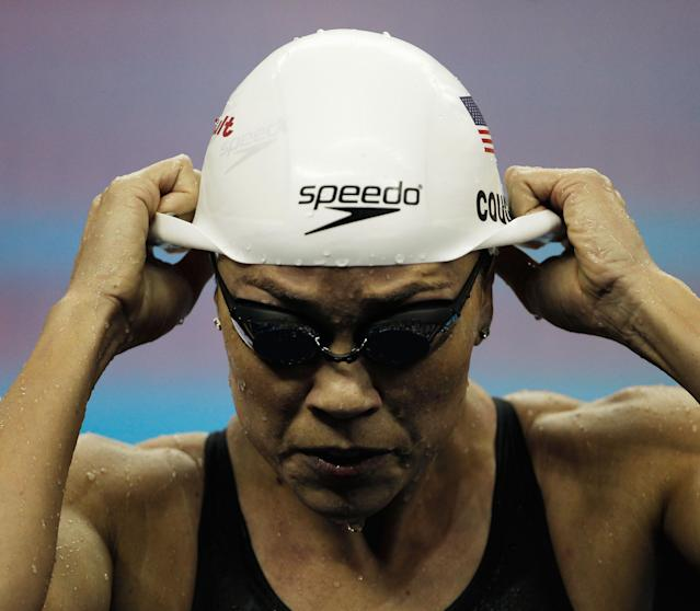 SHANGHAI, CHINA - JULY 28: Natalie Coughlin of the United States takes off her cap after she swam in heat nine of the Women's 100m Freestyle heats during Day Thirteen of the 14th FINA World Championships at the Oriental Sports Center on July 28, 2011 in Shanghai, China. (Photo by Lintao Zhang/Getty Images)