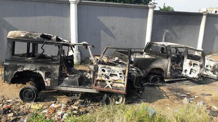 Burned cars are seen in the street after clashes between Members of Bundu dia Kongo, a religious cult, and Congolese security forces, in Kinshasa