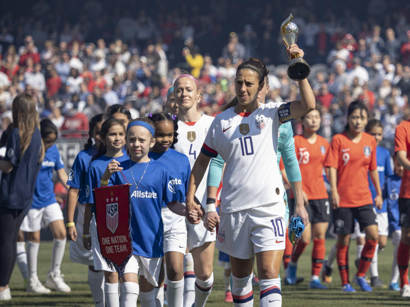 CHICAGO, IL - OCTOBER 06: The United States forward Carli Lloyd (10) takes the field with the World Cup before the five-game Victory Tour between Korea Republic and United States of America on Sunday, October 06, 2019 at Soldier Field in Chicago(Photo by Joseph Weiser/Icon Sportswire via Getty Images)