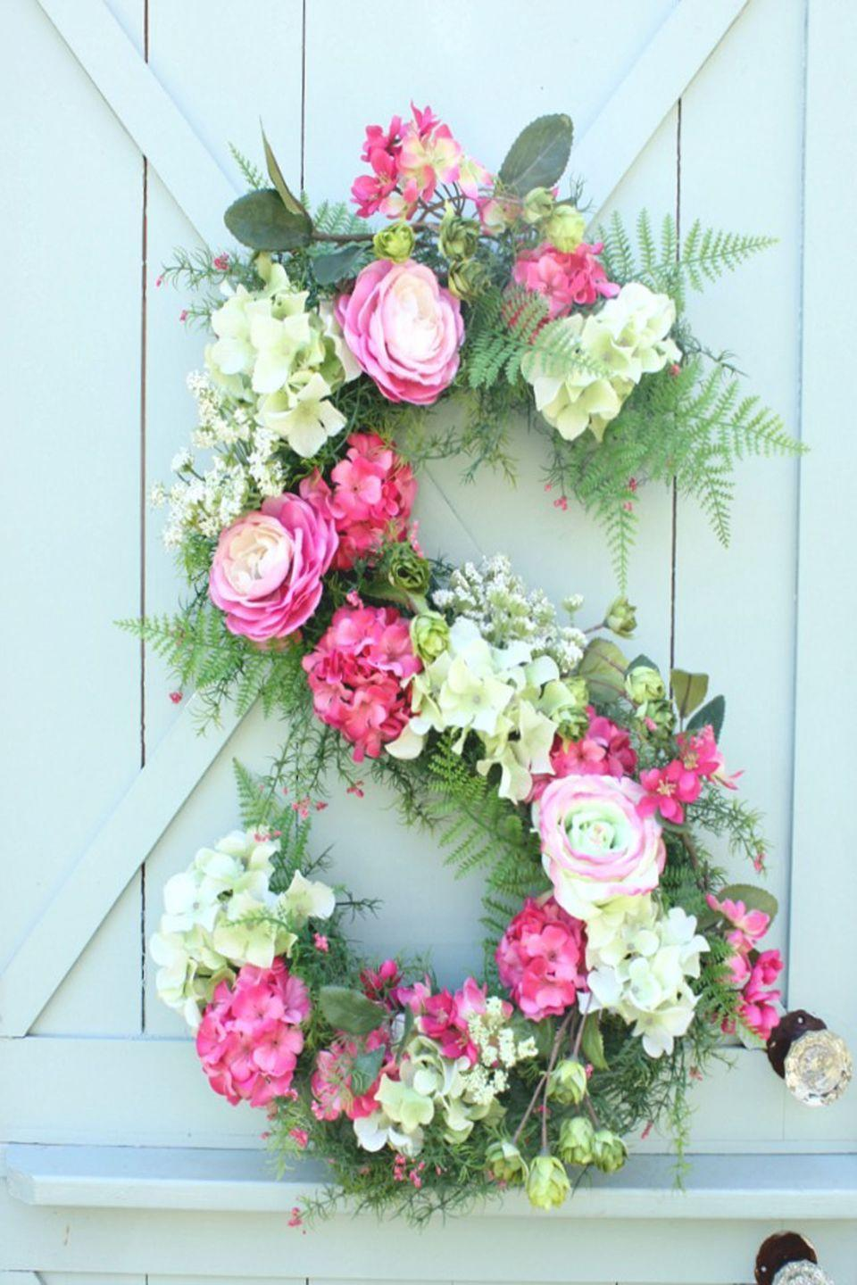 "<p>A monogrammed wreath is a sweet way to show off your family name. Give it as a gift or make one for yourself.</p><p><strong>Get the tutorial at <a href=""http://daisymaebelle.com/floral-monogram/"" rel=""nofollow noopener"" target=""_blank"" data-ylk=""slk:Daisy Mae Bell"" class=""link rapid-noclick-resp"">Daisy Mae Bell</a>.</strong></p><p><a class=""link rapid-noclick-resp"" href=""https://www.amazon.com/Oasis-Floral-Foam-Brick-Maxlife/dp/B0018N71RI?tag=syn-yahoo-20&ascsubtag=%5Bartid%7C10050.g.4395%5Bsrc%7Cyahoo-us"" rel=""nofollow noopener"" target=""_blank"" data-ylk=""slk:SHOP FLORAL FOAM"">SHOP FLORAL FOAM</a> </p>"