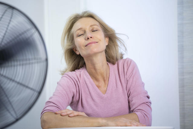 Some menopausal women find fans enough of a relief during a hot flush, while others opt for hormonal treatment. (Getty Images)
