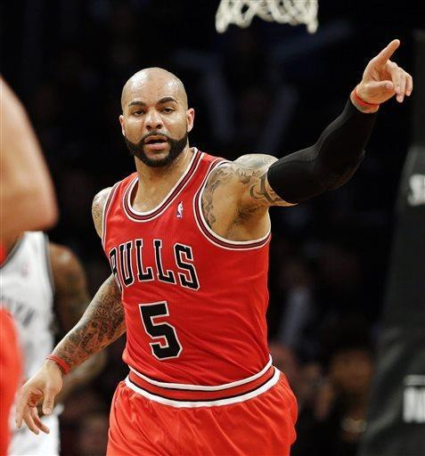 Chicago Bulls forward Carlos Boozer celebrates scoring against the Brooklyn Nets during the first half in Game 7 of their first-round NBA basketball playoff series in New York, Saturday, May 4, 2013. (AP Photo/Julio Cortez)