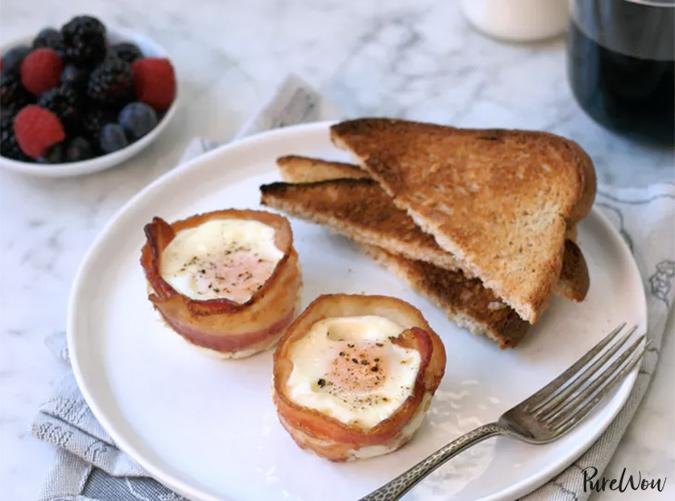 """<p>Now you could run through more than half your eggs with this recipe alone, or you could make a single serving. Decisions, decisions.</p> <p><a class=""""cta-button-link"""" href=""""https://www.purewow.com/recipes/Bacon-Wrapped-Eggs"""" target=""""_blank"""">Get the Recipe</a></p>"""