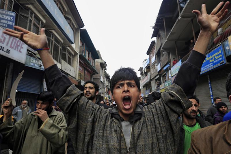 Supporters of Jammu Kashmir Liberation Front (JKLF) shout pro freedom slogans during a protest in Srinagar, India, Friday, March 7, 2014. Dozens of Muslim students from the disputed Indian territory of Kashmir were expelled from their university and briefly threatened with sedition charges because they cheered for the Pakistani cricket team during a televised match against archrival India, police said Thursday, while the Indian state's elected leader called for leniency. (AP Photo/Dar Yasin)