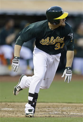 Oakland Athletics' Brandon Moss runs to first base after hitting an RBI triple off Kansas City Royals' Ervin Santana in the sixth inning of a baseball game Saturday, May 18, 2013, in Oakland, Calif. (AP Photo/Ben Margot)