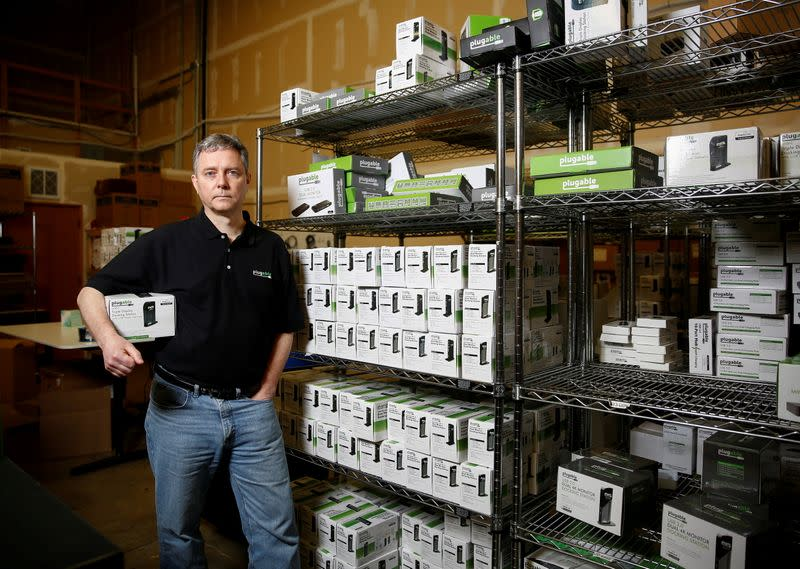 FILE PHOTO: Bernie Thompson of Plugable Technologies holds a docking station that he sells on Amazon.com