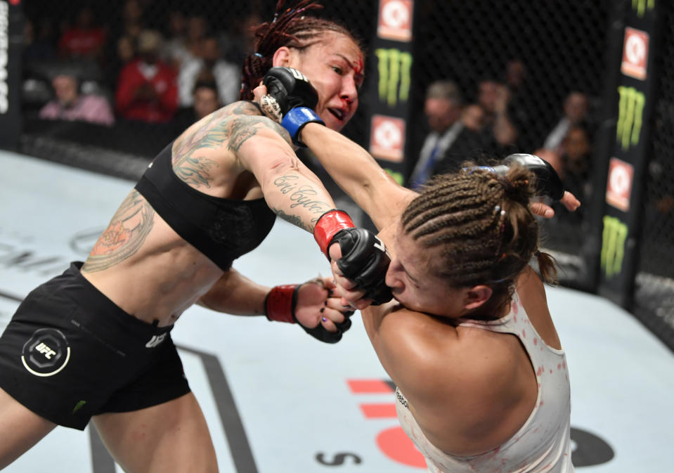 EDMONTON, ALBERTA - JULY 27:   (L-R) Cris Cyborg of Brazil punches Felicia Spencer of Canada in their featherweight bout during the UFC 240 event at Rogers Place on July 27, 2019 in Edmonton, Alberta, Canada. (Photo by Jeff Bottari/Zuffa LLC/Zuffa LLC)