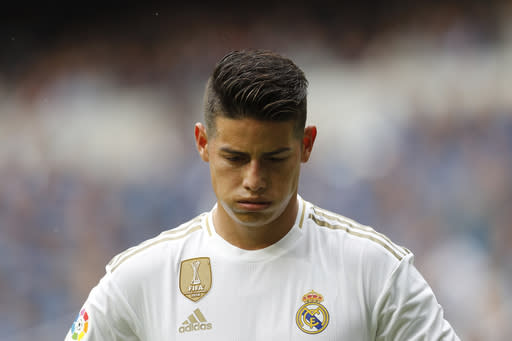 Real Madrid James Rodriguez looks down during the Spanish La Liga soccer match between Real Madrid and Levante at the Santiago Bernabeu stadium in Madrid, Spain, Saturday, Sept. 14, 2019. (AP Photo/Bernat Armangue)