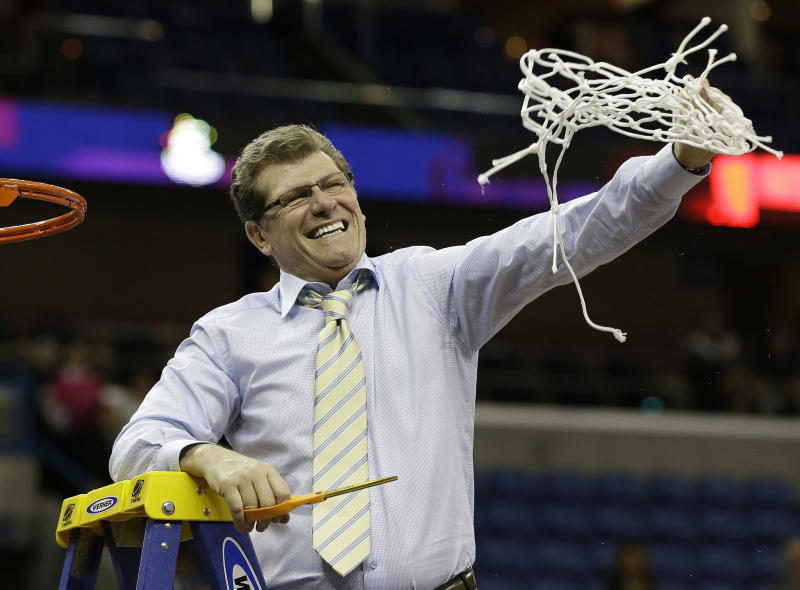Connecticut head coach Geno Auriemma reacts after cutting the net down with Connecticut players celebrating after defeating Louisville 93-60 in the national championship game of the women's Final Four of the NCAA college basketball tournament, Tuesday, April 9, 2013, in New Orleans. (AP Photo/Dave Martin)