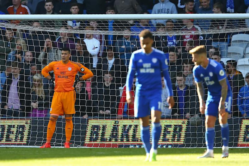 Cardiff City's English-born Filipino goalkeeper Neil Etheridge (L) reacts after conceding the opening goal during the English Premier League football match between between Cardiff City and Crystal Palace at Cardiff City Stadium in Cardiff, south Wales on May 4, 2019. (Photo by GEOFF CADDICK / AFP) / RESTRICTED TO EDITORIAL USE. No use with unauthorized audio, video, data, fixture lists, club/league logos or 'live' services. Online in-match use limited to 120 images. An additional 40 images may be used in extra time. No video emulation. Social media in-match use limited to 120 images. An additional 40 images may be used in extra time. No use in betting publications, games or single club/league/player publications. / (Photo credit should read GEOFF CADDICK/AFP/Getty Images)