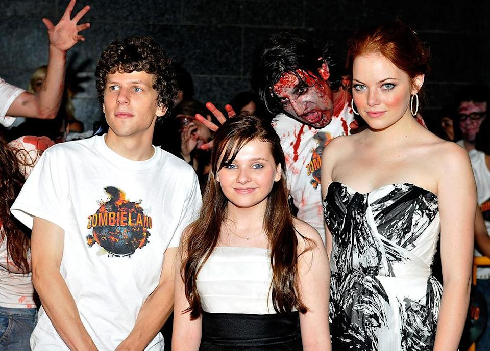 <p>Stone and cast mates Jesse Eisenberg and Abigail Breslin are surrounded by zombies at the premiere on Oct. 10, 2009, in Barcelona, Spain. This film becomes Stone's biggest hit to date. (Photo: Robert Marquardt/WireImage) </p>