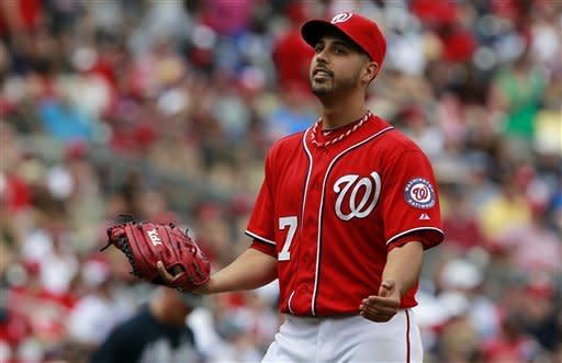 Washington Nationals starting pitcher Gio Gonzalez reacts as he is relieved during the fifth inning of a baseball game with the Atlanta Braves, Sunday, June 3, 2012, in Washington. The Braves won 3-2. (AP Photo/Alex Brandon)