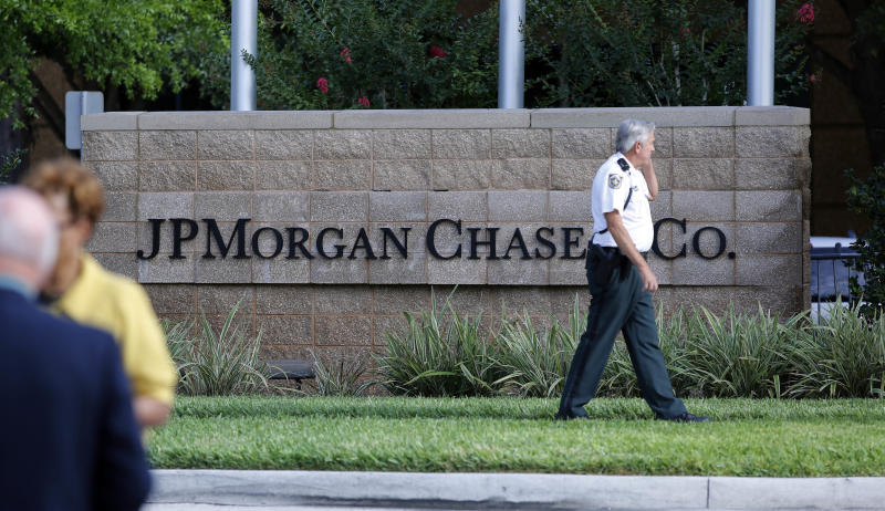 Hillsborough Sheriff deputy patrols outside the gate of JP Morgan Chase annual stockholders meeting held Tuesday, May 15, 2012, in Tampa, Fla. JPMorgan Chase CEO Jamie Dimon will speak to shareholders five days after disclosing a $2 billion trading loss. (AP Photo/Scott Iskowitz)