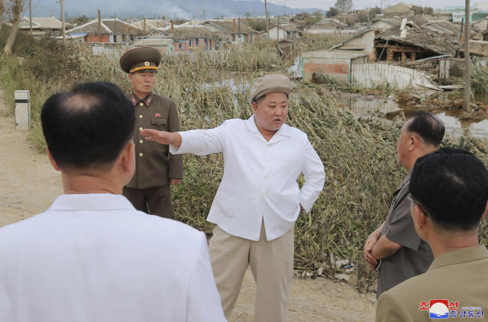 """In this Saturday, Sept. 5, 2020, photo provided by the North Korean government, North Korea leader Kim Jong Un talks to officials as he visits a damaged area in the South Hamgyong province, North Korea, following a typhoon known as Maysak. Independent journalists were not given access to cover the event depicted in this image distributed by the North Korean government. The content of this image is as provided and cannot be independently verified. Korean language watermark on image as provided by source reads: """"KCNA"""" which is the abbreviation for Korean Central News Agency. (Korean Central News Agency/Korea News Service via AP)"""