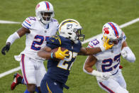 Los Angeles Chargers running back Joshua Kelley (27) runs the ball against Buffalo Bills strong safety Micah Hyde (23) during the second half of an NFL football game, Sunday, Nov. 29, 2020, in Orchard Park, N.Y. (AP Photo/Jeffrey T. Barnes)