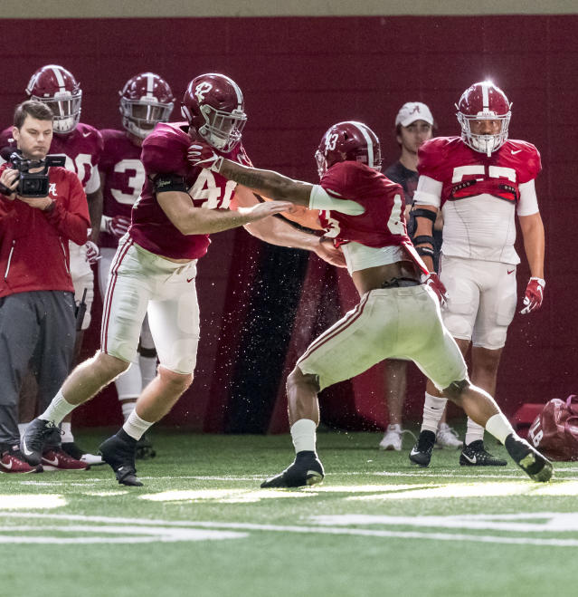 "Alabama linebacker Keith Holcombe (42) and linebacker <a class=""link rapid-noclick-resp"" href=""/college-football/players/279718/"" data-ylk=""slk:VanDarius Cowan"">VanDarius Cowan</a> (43) work through drills during football practice, Wednesday, Dec. 20, 2017, at the Hank Crisp Indoor Facility in Tuscaloosa, Ala. (Vasha Hunt/AL.com via AP)"