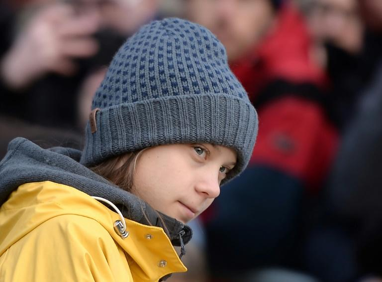 Swedish teen activist Greta Thunberg will be at Davos at the same time as US President Donald Trump, though the two are not expected to meet (AFP Photo/Filippo MONTEFORTE                  )