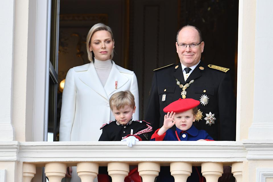 Princess Charlene of Monaco and Prince Albert II of Monaco with children Prince Jacques of Monaco and Princess Gabriella of Monaco pose at the Palace balcony during the Monaco National Day Celebrations