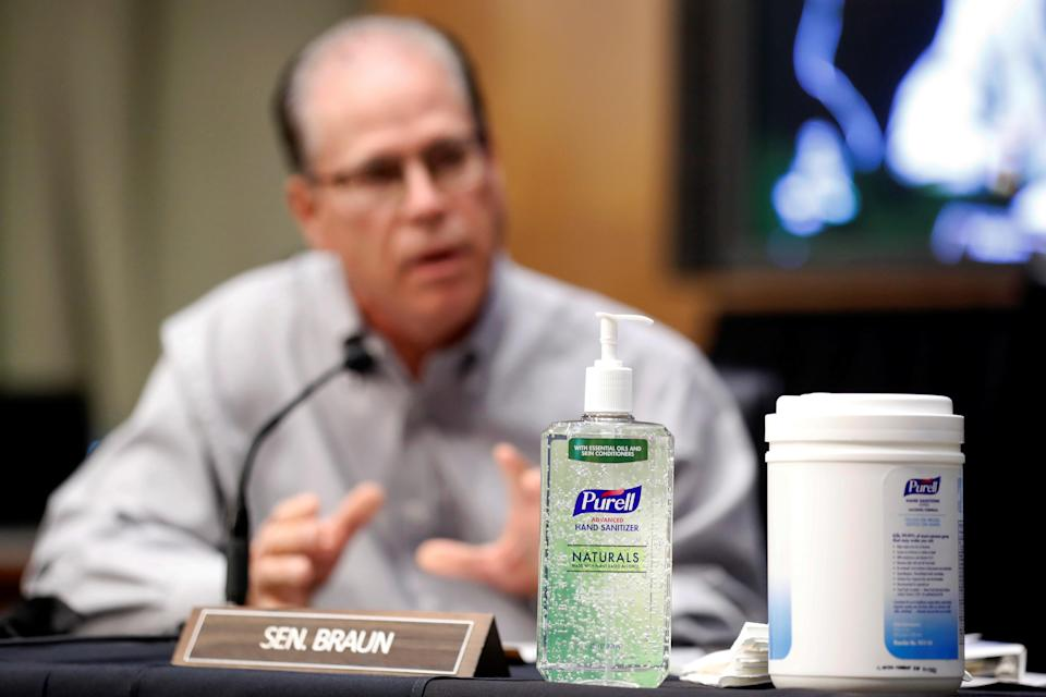 Hand sanitizer sits on a table as Sen. Mike Braun (R-IN) speaks during a Senate Health Education Labor and Pensions Committee hearing on new coronavirus disease (COVID-19) tests, on Capitol Hill in Washington, U.S., May 7, 2020. Andrew Harnik/Pool via REUTERS