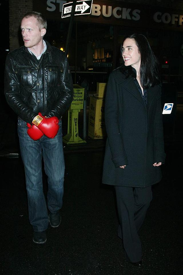 """Paul Bettany protects his privates from the paparazzi with a pair of bright red boxing gloves. Apparently he thinks wife Jennifer Connelly can fend for herself! Demis Maryannakis/<a href=""""http://www.splashnewsonline.com/"""" target=""""new"""">Splash News</a> - February 27, 2008"""
