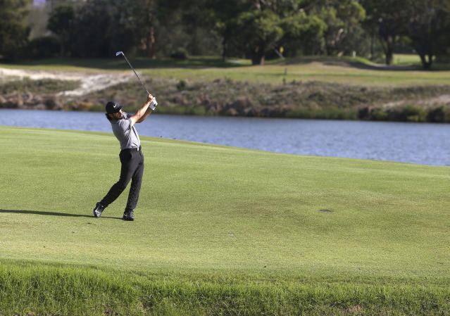 Abraham Ancer of Mexico hits his second shot on the 17th hole on his way to winning the Australian Open Golf tournament in Sydney, Sunday, Nov. 18, 2018. (AP Photo/Rick Rycroft)