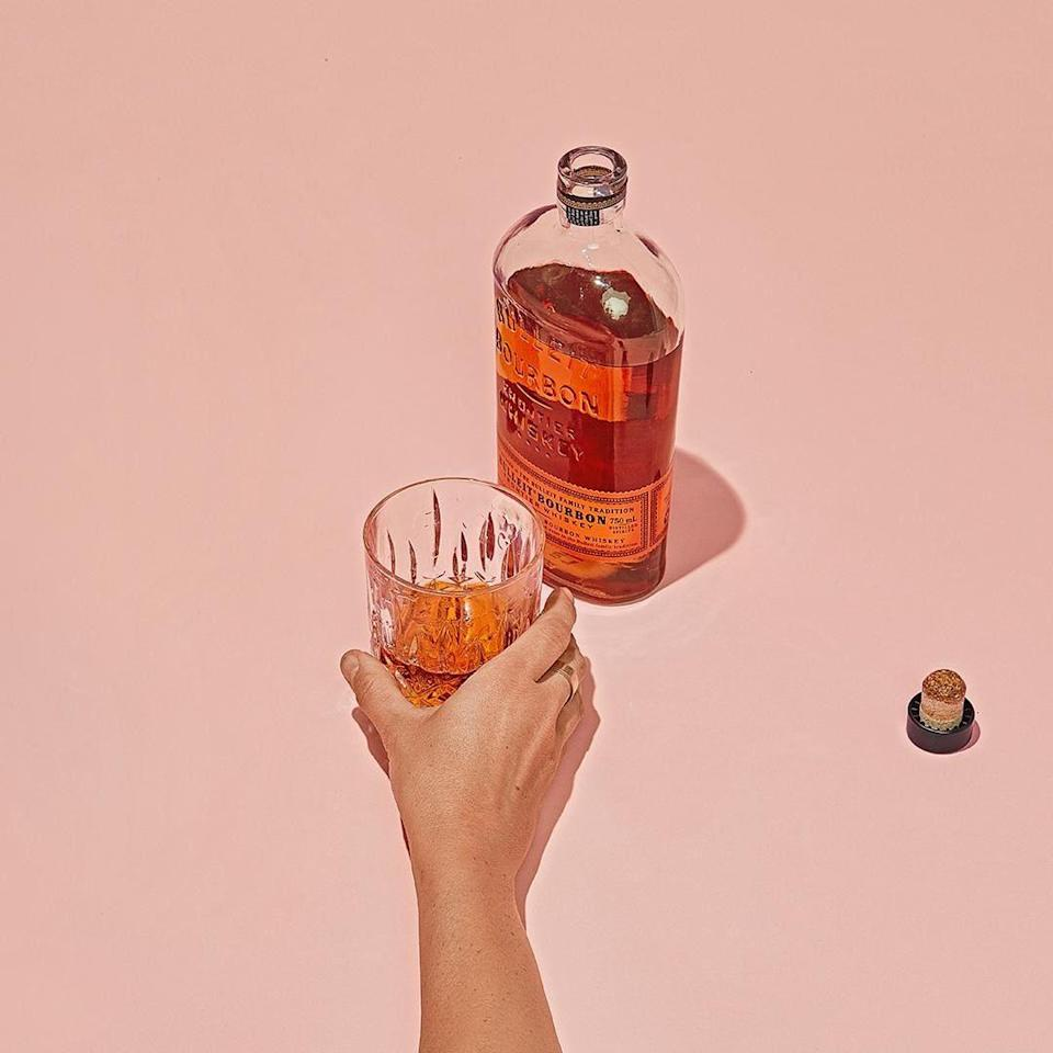 """Think of this as impromptu celebratory drinks without having to literally go out: Saucey delivers wine, beer, and liquor to their doorstep within 30 minutes, and it doesn't charge a delivery fee or have a minimum order value. The one caveat is that the <a href=""""https://www.glamour.com/gallery/best-alcohol-delivery-services?mbid=synd_yahoo_rss"""" rel=""""nofollow noopener"""" target=""""_blank"""" data-ylk=""""slk:alcohol delivery service"""" class=""""link rapid-noclick-resp"""">alcohol delivery service</a> operates only in larger metropolitan areas: Chicago, Dallas, Los Angeles, New York City, Sacramento, San Diego, San Francisco Bay Area, and Washington, D.C. $19.99, Saucey. <a href=""""https://www.saucey.com/bourbon-whiskey/bulleit-bourbon/WS-BULLST-750"""" rel=""""nofollow noopener"""" target=""""_blank"""" data-ylk=""""slk:Get it now!"""" class=""""link rapid-noclick-resp"""">Get it now!</a>"""