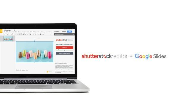 Silver laptop computer with Shutterstock editor program on display.