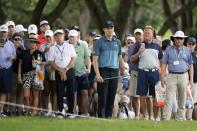 The gallery looks on as Jordan Spieth prepares to hit from behind the ropes during the third round of the Charles Schwab Challenge golf tournament at the Colonial Country Club in Fort Worth, Texas, Saturday May 29, 2021. (AP Photo/Ron Jenkins)