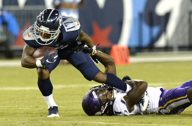 Tennessee Titans wide receiver Cameron Batson (17) is brought down by Minnesota Vikings defensive back Holton Hill in the first half of a preseason NFL football game Thursday, Aug. 30, 2018, in Nashville, Tenn. (AP Photo/Mark Zaleski)