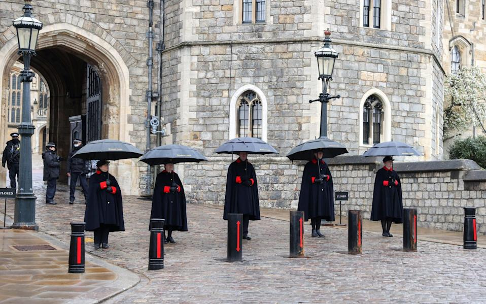 Windsor Castle Wardens stand guard outside the castle as rain begins to fall on April 12, 2021 in Windsor, England. - Chris Jackson/Getty