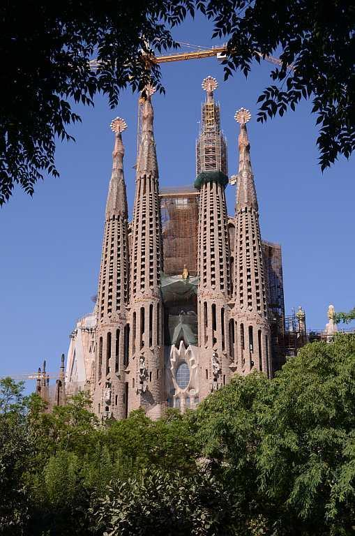Sagrada Familia, Barcelona Spain Sagrada Familia is unlike any other basilica I have seen in the world. It has been under construction since 1882. Designed by maverick architect Antoni Gaudi, this masterpiece is a living monument and a testimony to the architect's style. It is is one of the key landmarks of Barcelona. The Nativity Façade, which shows images from Christ's birth, has the architectural stamp of Gaudi in its symbolism. It represents Christmas and is referred to as the Façade of Life. It is a fusion of Gothic and Art Nouveau. While many debate over the style and the ornate design of the monument, Sagrada Familia continues to be built with donations from people even after 130 years. View a slideshow about Sagrada Familia https://in.lifestyle.yahoo.com/photos/sagrada-familia-barcelona-s-great-living-basilica-slideshow/