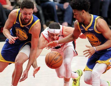 May 20, 2019; Portland, OR, USA; Golden State Warriors guard Klay Thompson (11) and Warriors' guard Quinn Cook (4) strip the ball from Portland Trail Blazers guard Seth Curry (31) in the first half of game four of the Western conference finals of the 2019 NBA Playoffs at Moda Center. Mandatory Credit: Jaime Valdez-USA TODAY Sports
